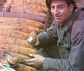 English man eating on ammo casings
