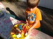 John Williams exploring with rainbow playdough