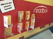 """Readbox"" Bulletin Board Display with Book Cover Designs and QR Code Shortcuts to Trailers"