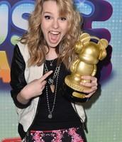 Bridgit holding her Radio Disney Music Award