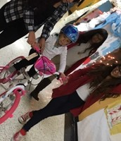 High school students lending a helping hand with a new bike!