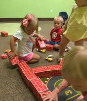 The class builds a brick wall for a farm.