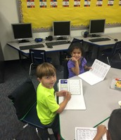 Kinder organizing their Writer's Notebook!
