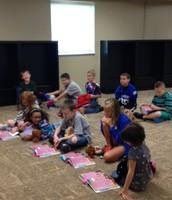 Students watching thier peers perform.