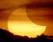 super moon partial solar eclipse
