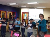 Several students were selected to read their work.