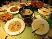These are plates of Various Chinese dishes.