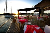 Our Restaurant is on an old docked boat located on a salt marsh in Wilmington, North Carolina
