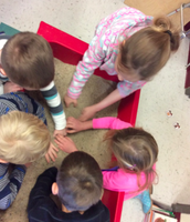 looking for rhyming words in the sand table