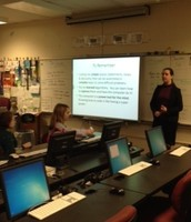 Students learn about coding from recent grad Erin Brady!