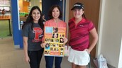PHS Librarian poses with Sharyland ISD high school students.