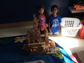 Alexis and Shrey using team work and building a tower