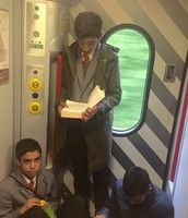 Students utilising their time by reading on the journey back!