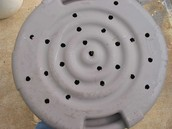 Drill holes in bottoms of your pots