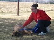 Amanda taking care of a dog