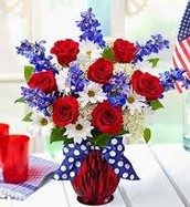 Red roses with white daisies and delphinium