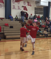 Keaton Porth and the JV warm up for a JV boys game against Mid-Buchanan