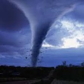 1st the tornado forms then comes and hits the ground.