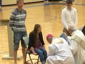 Bishop Warfel washes feet
