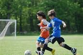 Boys playing a friendly match.