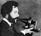 Alexander Graham Bell with his invention- the telephone