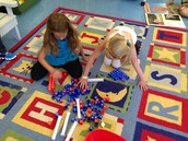 Grace and Savanna building sight words.