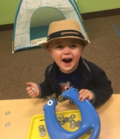 Copeland in his superfine hat, playing with magnets….