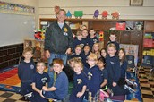 The DEA visited our 3rd graders with his buddy!
