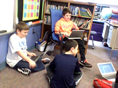 Students holding an accountable talk book club meeting