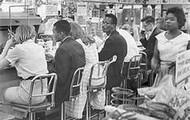 Black people sit in