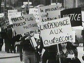 Protesters holding up signs in Quebec