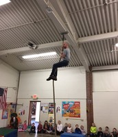 Mr. Shaw modeling for students how to climb the rope.