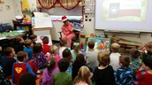 Assistant Principal Ms. Lout reads to Kindergarten