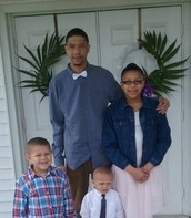 Anthony and his children outside of church on Easter Sunday.