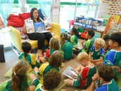Grade 1AMc are learning about the different genres of books in their class library
