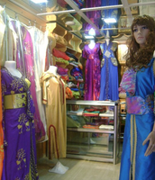 A small shop in Morocco selling traditional female clothing.