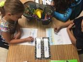 Ms. Davishines's 1st graders developing stories during writing time!