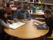 Ms. Williams conferencing with 4th graders.