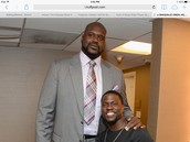 Kevin hart next to Shaquille o Neil
