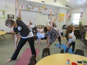Relaxing yoga with Dr. Vera Ramos in Mrs. Heupler's class