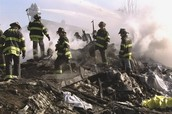 Fire fighters look for survivors and bodies after the Twin Towers fell.