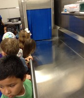 Learning how to wash dishes in the lunchroom!