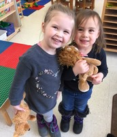 Two friends in Mrs. Smith's Threes sharing smiles and teddy bears as they learn about hibernation