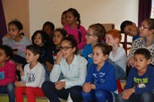 Some children listening to the Christmas Story