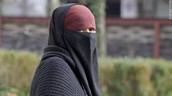 Women forced to wear All covering Burqa