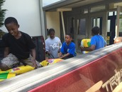 4th graders unloading one of the trucks