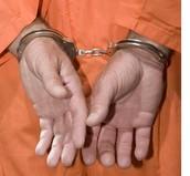 Murderer in hand cuffs