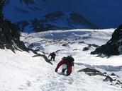 Mountaineers climbing a mountain.