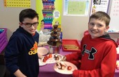 5th Graders Christopher and Kaden enjoy treats with a chocolate fountain in Mr. Tomlinson's room during their Valentine's party.