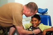 A Doctor Helping a Boy with Cerebral Palsy